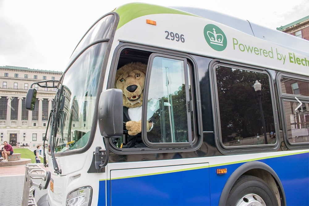 Roar-ee in driver's seat of electric bus