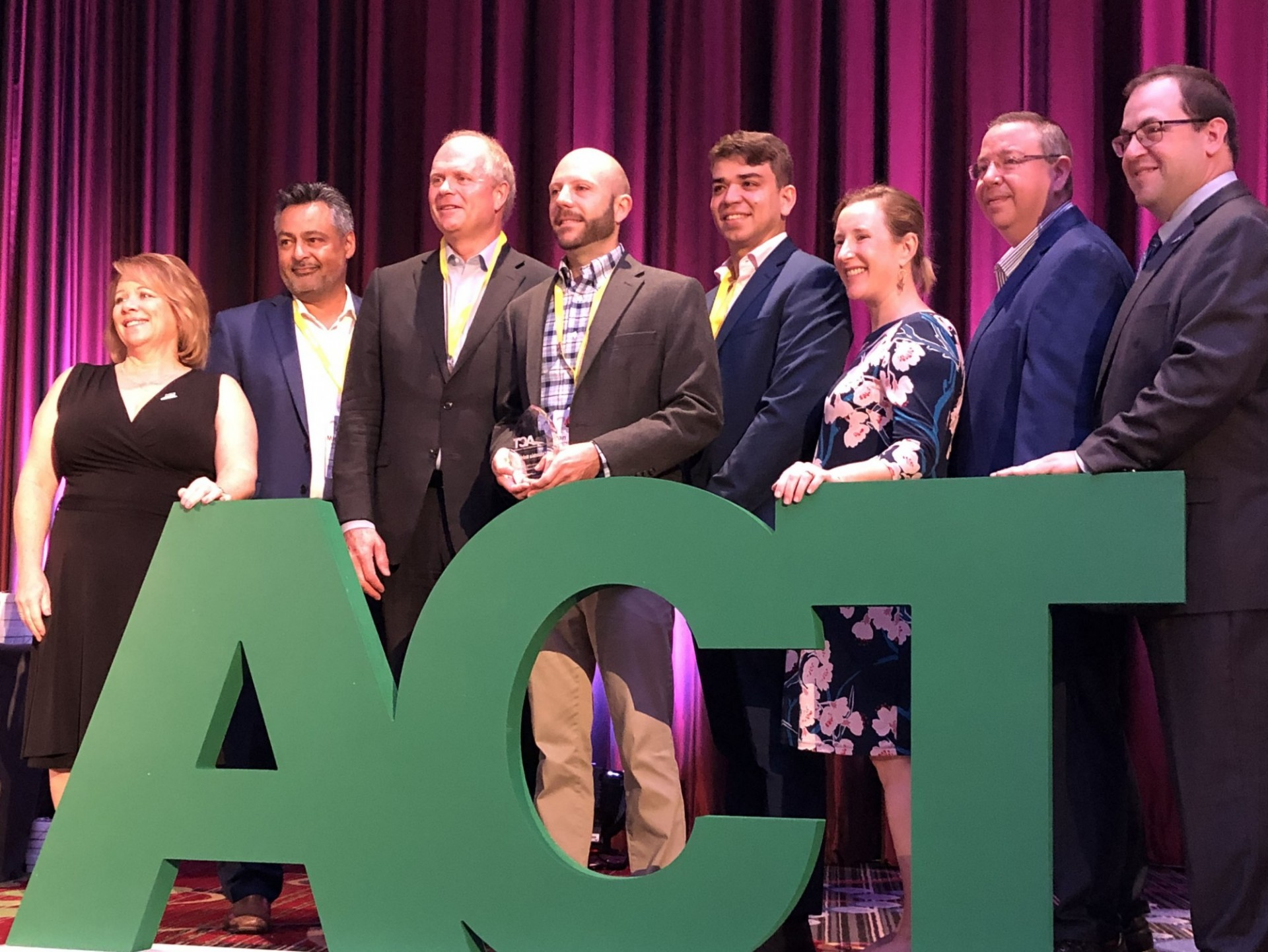 Columbia University representatives from the Transportation and Environmental Stewardship offices accept the award from ACT at the International Conference on August 7, 2019.