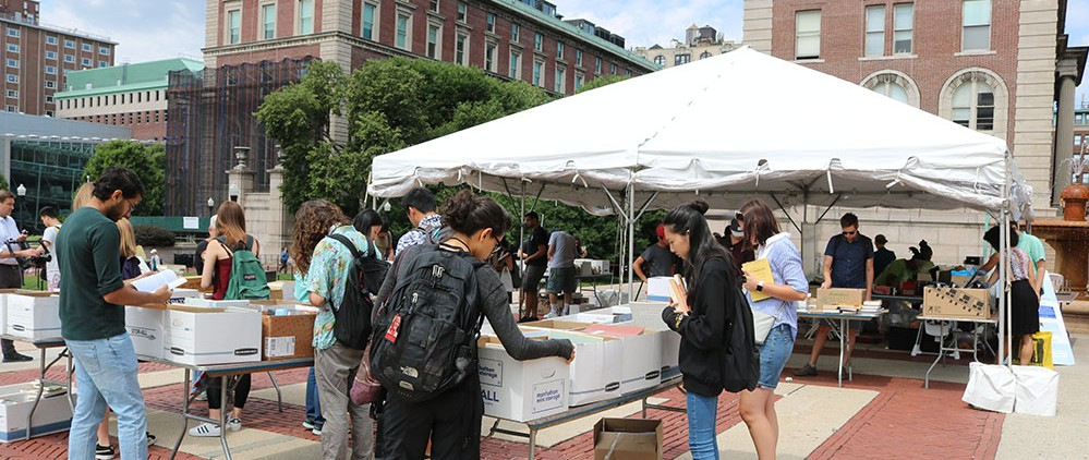 Clean and Go Green tents set up on College Walk in the summer